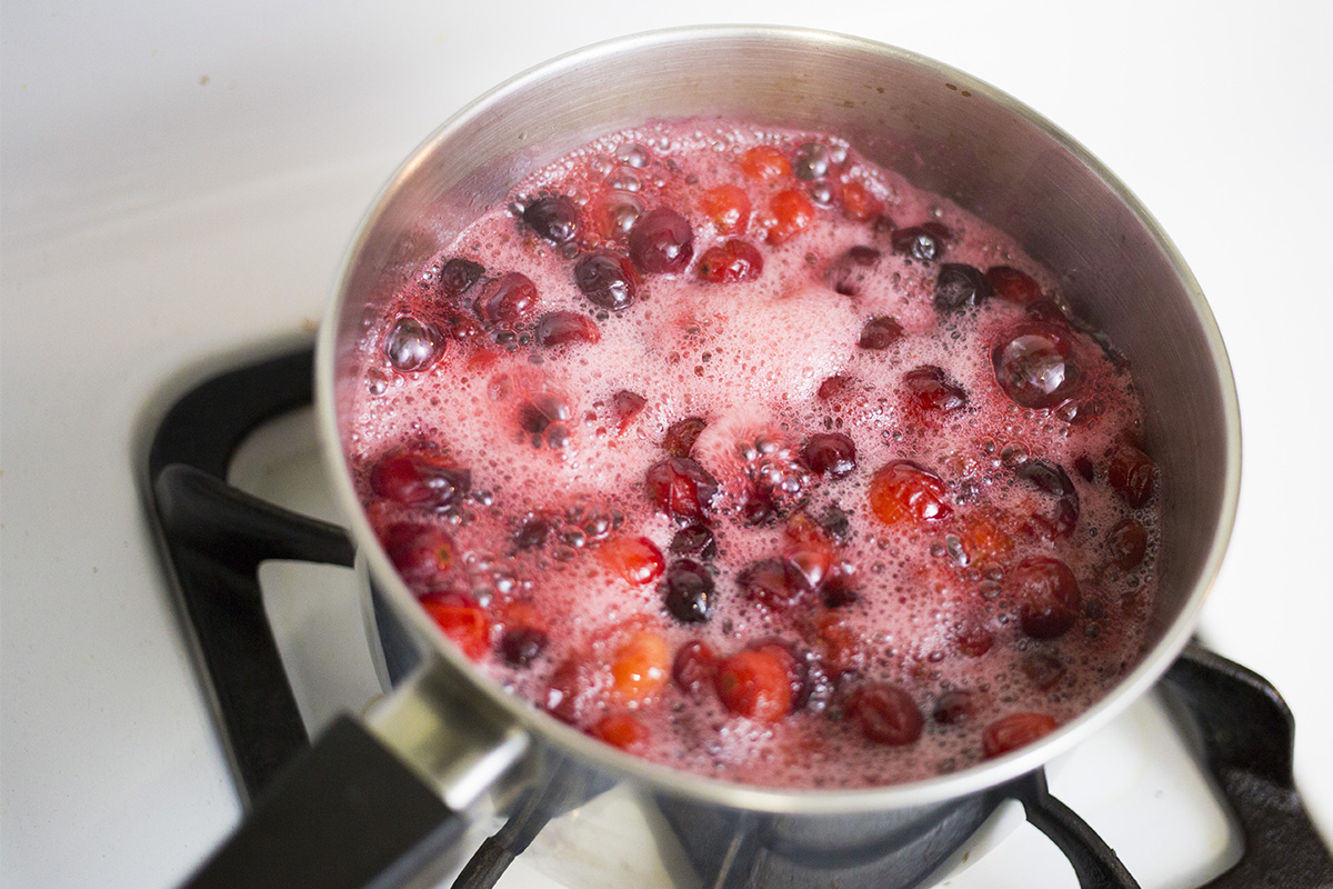 Bringing cranberry mixture to a boil.